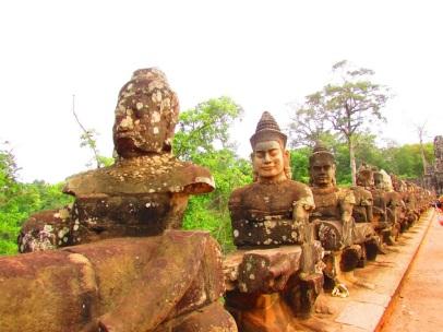 Guardians at the gate of Angkor Thom.