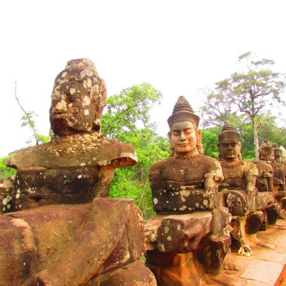 Guardians at the gate of Angkor Thom.