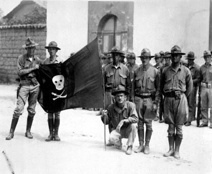 U.S. Marines holding Sandino's battle flag - Nicaragua, 1932.
