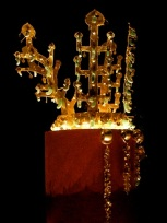 Gold Crown of the Silla Queen. This crown was found in the tomb of a Silla queen and stands nearly a foot tall. The crown is known for its abundant use of jade, obtained in trade from China.