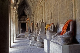 Buddhist idols in the hall at Angkor Wat.
