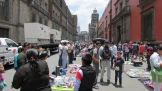 Market in modern Mexico City, wares displayed on blankets like in old Tenochtitlan.