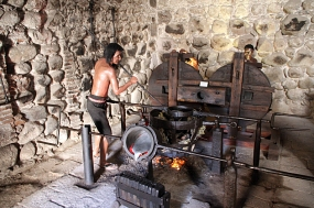 Indigenous laborers added mercury to raw ore, before burning it off to extract pure silver. Mercury is incredibly poisonous, and most laborers doing this job were dead within months. Molten silver is poured into a mold in order to create pure bars.