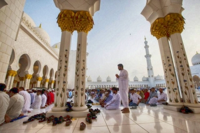 Worshipers remove their shoes during prayer as part of wudu, the act of ritual cleanliness expected from Muslims.