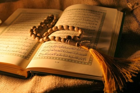 Quran with misbaha, Islamic prayer beads.
