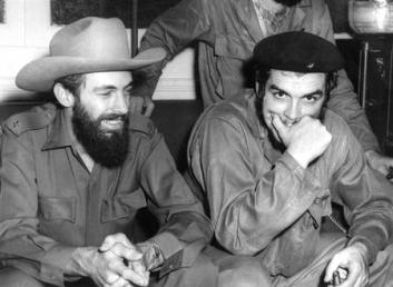 This August 1959 photo shows Cuban revolutionary legends Comandante Camilo Cienfuegos (L) and Comandante Ernesto Che Guevara in Havana. Camilo died in a plane crash 28 October 1959 during a military mission and Guevara was executed in Bolivia 08 October 1967.