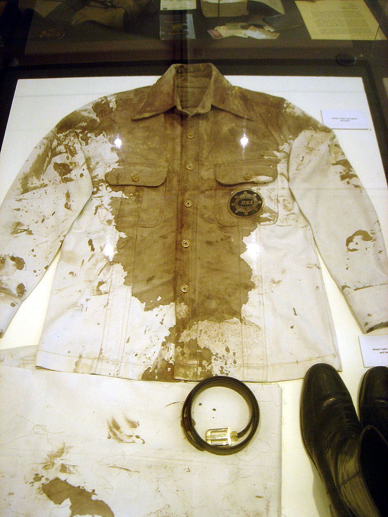 800px-Ninoy's_bloodied_jacket,_belt_and_boots