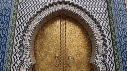 Fez's Palais Royale may be a modern palace, but it hints at the fantastic wealth of Idris I's ancient capital. These large brass doors stand nearly a dozen feet tall. They are surrounded by sumptuous zellige (colorful geometric mosaic tilework) and carved cedar wood.