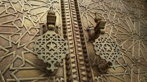 One set among the dozens of front doors to the royal palace in Fez, each featuring intricate decorative work produced at great expense - again, paid for through taxes on the trans-Saharan trade.