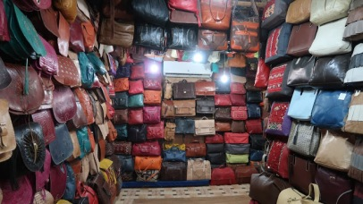 The end result of this process is a colorful array of bags, clothing, and other leather goods.