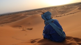 If men cover their heads, it is often with a wrapping as seen in this photo, which shields their heads and faces from the heat of the sun and the any sand on the wind.