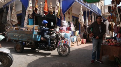 Occasionally, streets of the medina are wide enough to accommodate small motorbikes, such as this one making deliveries in the souk of Essaouira, Morocco.
