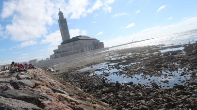 "The King Hassan II Mosque is the largest mosque in Africa, and the 5th largest in the world. Its minaret is the world's second tallest minaret at 210 metres (689 ft). Mosque King Hassan II, son of Mohammed V, requested for the best of the country's artisans to come forward and submit plans for a mausoleum to honour the departed king; it should ""reflect the fervor and veneration with which this illustrious man was regarded."""